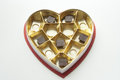 Chocolates in a Heart shaped tin and box Royalty Free Stock Photo