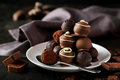 Chocolates on plate on the black background Stock Photos