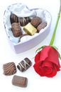 Chocolates and red rose Stock Photography
