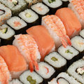 Choice of japanese sushi collection with rice salmon and vegetables Royalty Free Stock Photography