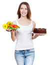 Choice between vegetables and chocolate cake making hard Stock Images
