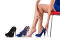 Choice of woman shoes on white Royalty Free Stock Images