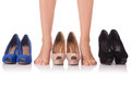 Choice of woman shoes on white Royalty Free Stock Photos