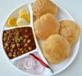 Chole puri indian meal consisting of and puris as the main dish Royalty Free Stock Photos