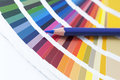 Choosing color from the spectrum open pantone card with blue pencil Stock Image