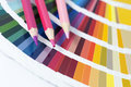 Choosing color from the spectrum open pantone card with three pencils Royalty Free Stock Photo