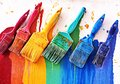 Choosing colors brushes for painting walls Royalty Free Stock Image