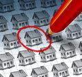 Choosing a home and house search concept with red pencil crayon highlighting drawing from group of houses as symbol of Royalty Free Stock Image