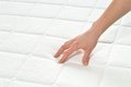 Choosing mattress and bed close up of female hand touching testing in a store copy space Stock Image
