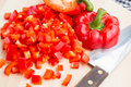Chop red sweet bell peppers with knife Stock Image