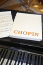 Chopin classical musical score with piano and background Royalty Free Stock Photo
