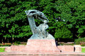Chopin statue at royal baths park lazienki in warsaw poland Royalty Free Stock Photos