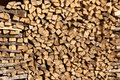 Chopped aspen firewood stacked up in a pile. Royalty Free Stock Photo