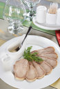 Chopped boiled beef tongue in a plate on the served table Stock Photos