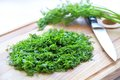 Chopped dill on wooden cutting board Royalty Free Stock Images