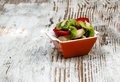 Chopped fruit bowl surrounded rustic background Royalty Free Stock Photography