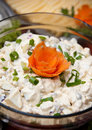 Chopped herring salad with sour cream in a glass bowl garnished with chives Royalty Free Stock Image