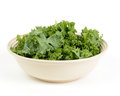 Chopped kale salad in a bowl isolated on white background Royalty Free Stock Photos