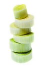 Chopped leek some pieces of stacked on white background Royalty Free Stock Photos