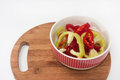 Chopped red and green peppers in a bowl Royalty Free Stock Photo