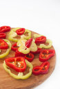 Chopped red and green peppers on the kitchen wooden board Royalty Free Stock Photo
