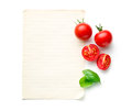 Chopped tomatoes and basil leaf with blank paper Royalty Free Stock Photo