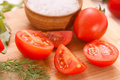 Chopped tomatoes with salt and dill Stock Photography