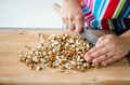 Chopping almonds woman with japanese knife Stock Photo