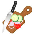 Chopping board and vegetables wooden with knife slices of Stock Images