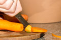 Chopping carrot for the salad Stock Photo