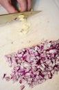Chopping garlic Royalty Free Stock Photo