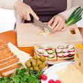 Chopping spring onion and preparing sandwiches Stock Photo