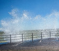 Choppy sea at broadstairs splashing against rocks blue sky sunny day Royalty Free Stock Photography