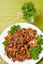 Chops from pork with cedar nutlets (top view) Royalty Free Stock Images