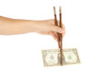 Chopstick hand with and one dollar banknotes isolate on white background Stock Image