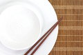 Chopsticks and Asian table setting Royalty Free Stock Photo