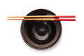 Chopsticks and black bowl isolated on white background Stock Photo