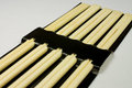 Chopsticks five pairs of in a black package Royalty Free Stock Image