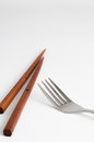 Chopsticks and fork with white background Royalty Free Stock Photo