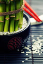 Chopsticks and a lucky bamboo plant oriental style table serving concept Stock Images