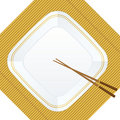 Chopsticks and plate on bamboo cover Royalty Free Stock Photo