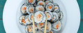 Chopsticks and sushi maki gunkan roll platter set Royalty Free Stock Photo