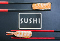 Chopsticks and two sushi with salmon and shrimp blackboard Stock Photo