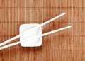 Chopsticks on a white ceramic cup Royalty Free Stock Photos