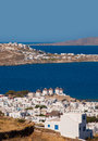 Chora of mykonos with windmills in greece on the background the sea and islands Stock Photos