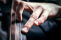 Chord hand cellist compressive сlose up Royalty Free Stock Photo