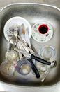 Chores, dirty dishes in the sink Royalty Free Stock Photo