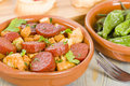 Chorizo bread and padron peppers tapas spanish dishes pinchos with on background Stock Photo