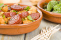 Chorizo bread and padron peppers tapas spanish dishes pinchos with on background Royalty Free Stock Images