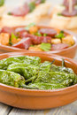 Chorizo bread and padron peppers tapas spanish dishes pinchos with on background Stock Image